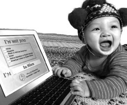baby looking at computer screen